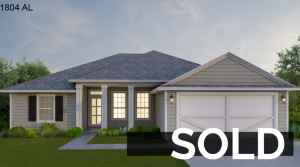 Light green home with garage by Collin's Builders that is sold